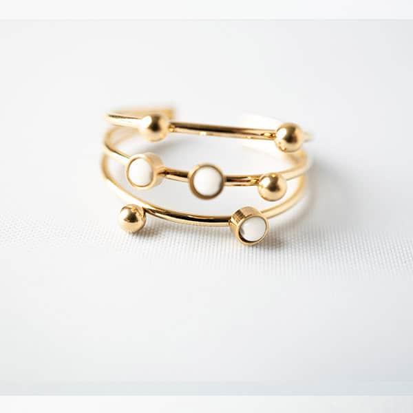 gouden ring met witte steentjes zag bijoux